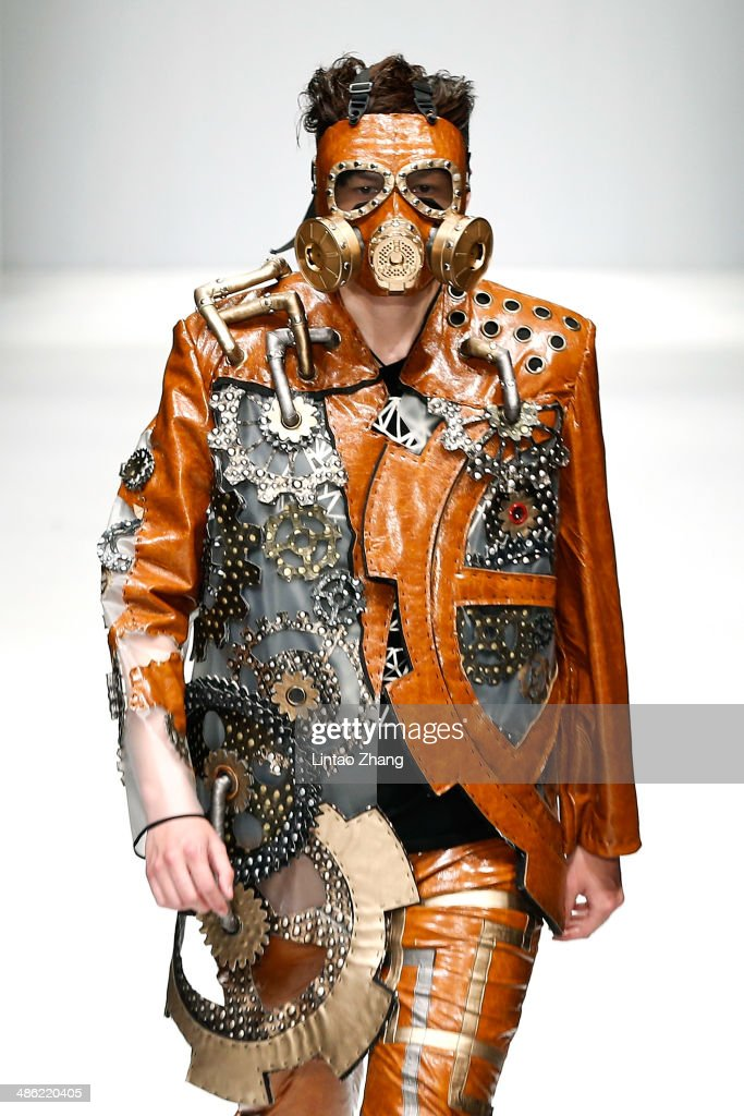 A model showcases designs on the runway by China Academy of Art School of Design Graduates Show during the 2014 China Graduate Fashion Weekat the 751D-PARK Workshop on April 23, 2014 in Beijing, China.