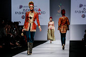 A model showcases designs on the runway by Dian Pelangi during the Jakarta Fashion Week 2015 at Senayan City on November 1 2014 in Jakarta Indonesia