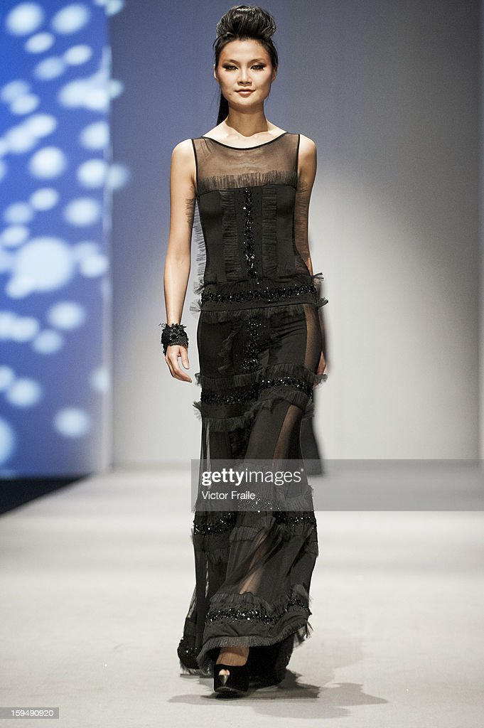 A model showcases designs on the runway by Espen Salberg during the Sunset Soiree show on day 1 of Hong Kong Fashion Week Autumn/Winter 2013 at the Convention and Exhibition Centre on January 14, 2013 in Hong Kong, China.