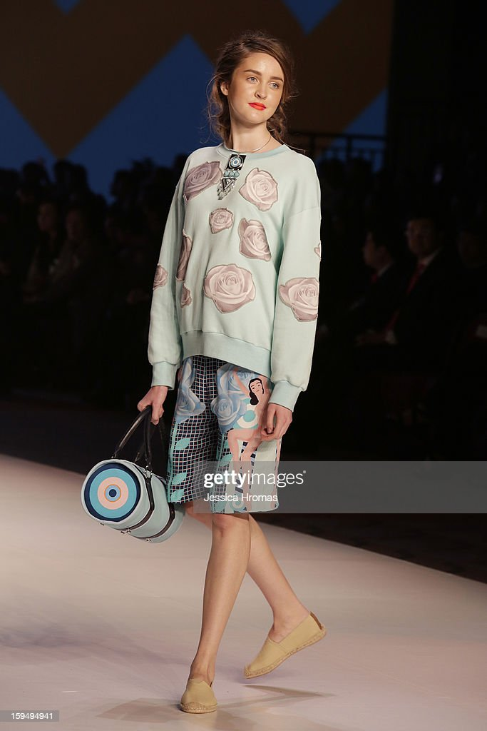 A model showcases designs on the runway by Holly Fulton during the 'Hong Kong Fashion Extravaganza' show on day 1 of Hong Kong Fashion Week Autumn/Winter 2013 at the Hong Kong Convention and Exhibition Centre on January 14, 2013 in Hong Kong, Hong Kong.