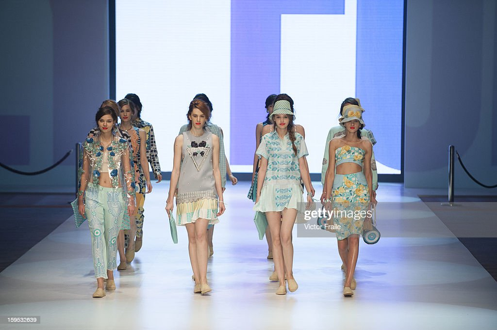 A model showcases designs on the runway by Holly Fulton during the Extravaganza show on day 1 of Hong Kong Fashion Week Autumn/Winter 2013 at the Convention and Exhibition Centre on January 14, 2013 in Hong Kong, China.
