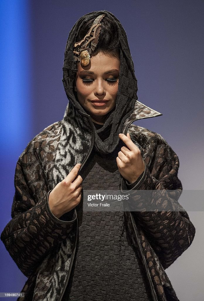 A model showcases designs on the runway by IKA Butoni during the Autumn Breeze show on day 1 of Hong Kong Fashion Week Autumn/Winter 2013 at the Convention and Exhibition Centre on January 14, 2013 in Hong Kong, China.