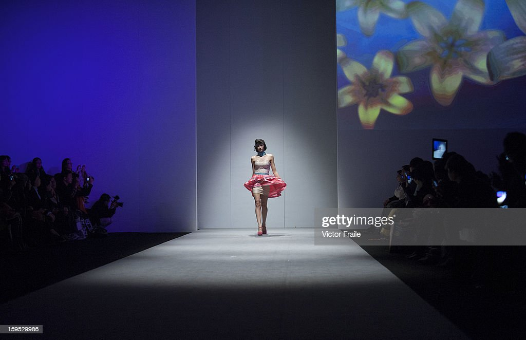 A model showcases designs on the runway by Jeanny Ang on day 2 of Hong Kong Fashion Week Autumn/Winter 2013 at the Convention and Exhibition Centre on January 15, 2013 in Hong Kong, China.