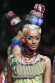 A model showcases designs on the runway by Lenny Agustin during the Lennor show on the fourth day of Jakarta Fashion Week 2010 at Pacific Place on...