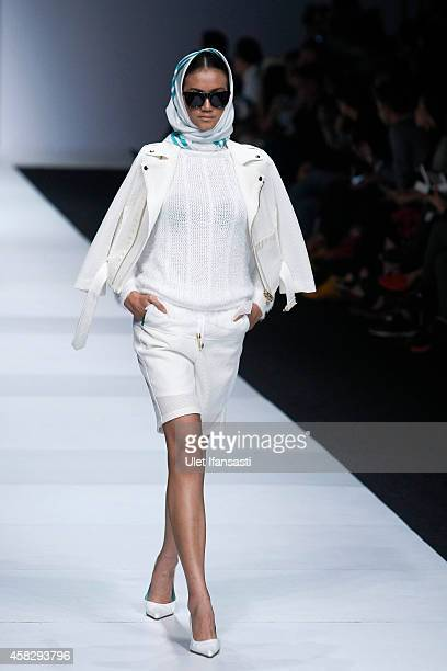 A model showcases designs on the runway by Mannequins during the Jakarta Fashion Week 2015 at Senayan City on November 2 2014 in Jakarta Indonesia