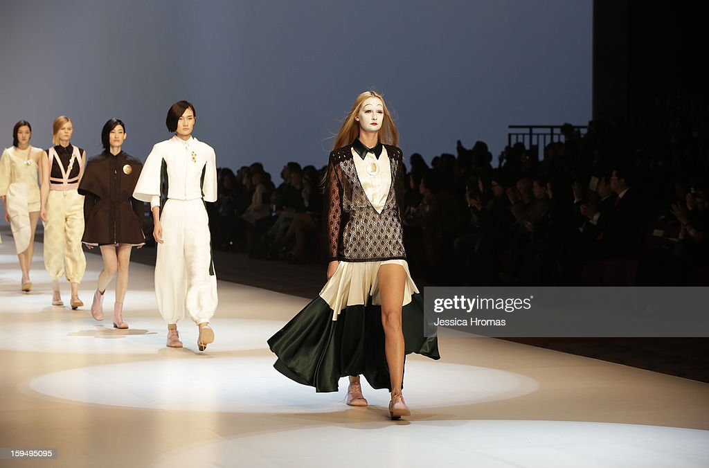 A model showcases designs on the runway by Nana Aganovich and Brook Taylor during the Hong Kong Fashion Extravaganza show on day 1 of Hong Kong Fashion Week Autumn/Winter 2013 at the Hong Kong Convention and Exhibition Centre on January 14, 2013 in Hong Kong, Hong Kong.