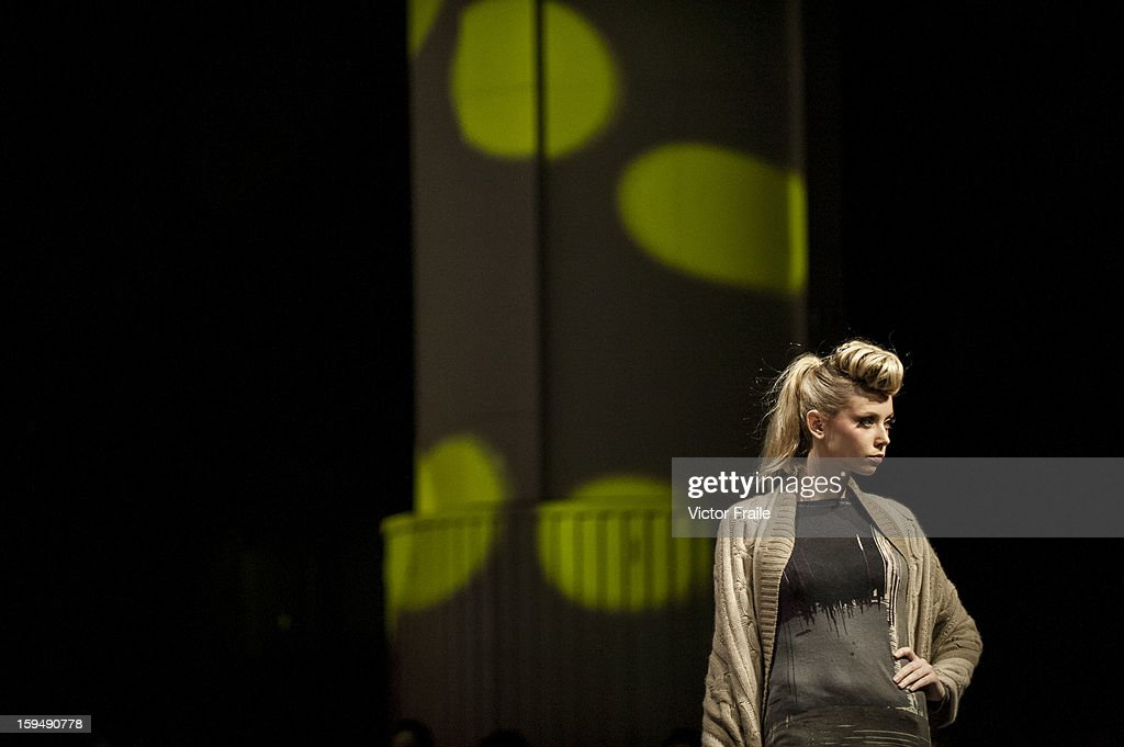 A model showcases designs on the runway by Pashma during the Memory Lane show on day 1 of Hong Kong Fashion Week Autumn/Winter 2013 at the Convention and Exhibition Centre on January 14, 2013 in Hong Kong, China.