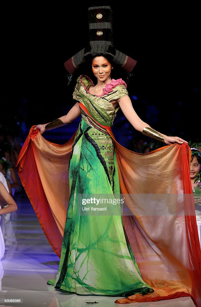 A model showcases designs on the runway by Sariayu Marta Tilaar as part of Save Sumatra prior to the APPMI Show 6 on day three of Jakarta Fashion Week 2009 at the Fashion Tent, Pacific Place on November 16, 2009 in Jakarta, Indonesia.