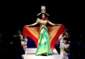 A model showcases designs on the runway by Sariayu Marta Tilaar as part of Save Sumatra prior to the APPMI Show 6 on day three of Jakarta Fashion...