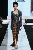 A model showcases designs on the runway by Susi Lucon as part of the Opening Night 'Styling Modernity A Tribute To Kebaya' show opening Jakarta...
