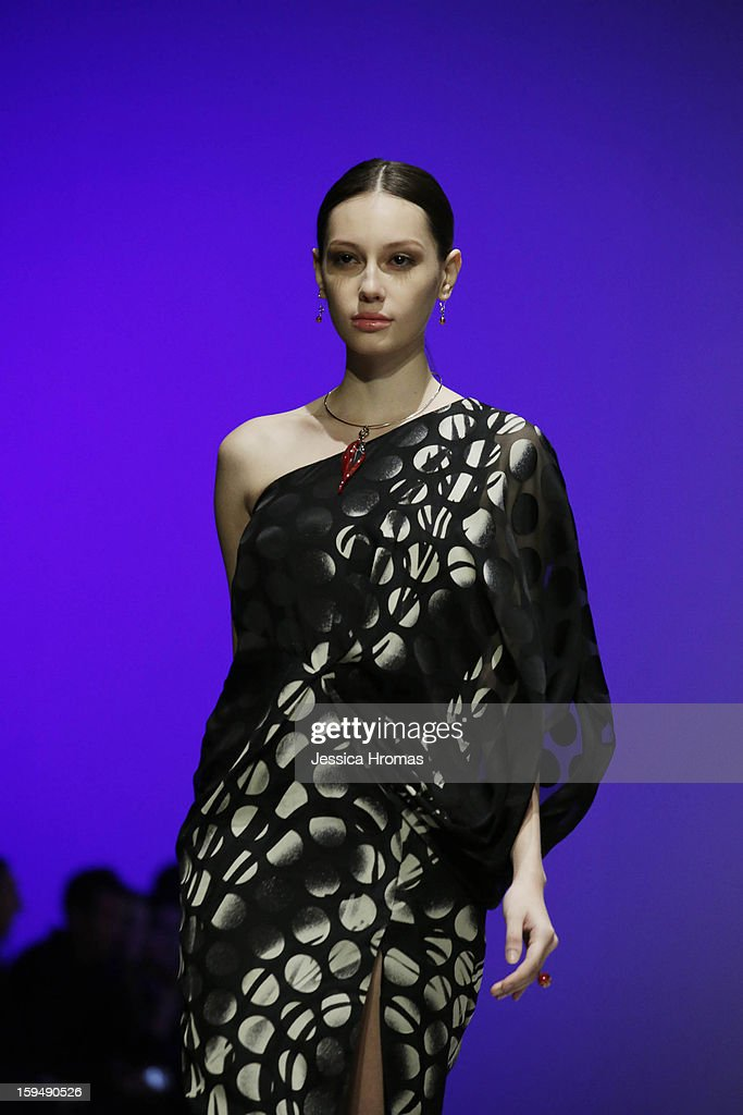 A model showcases designs on the runway by Yokang X Joia during the Solvita show on day 1 of Hong Kong Fashion Week Autumn/Winter 2013 at the Hong Kong Convention and Exhibition Centre on January 14, 2013 in Hong Kong, Hong Kong.