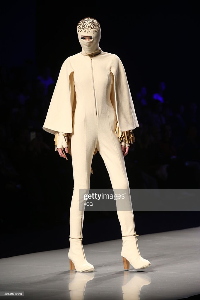 A model showcases designs on the runway during the 22nd Hempel Award China Young Fashion Design Contest on day one of the 2014/15 Mercedes-Benz China Fashion Week A/W on March 25, 2014 in Beijing, China.