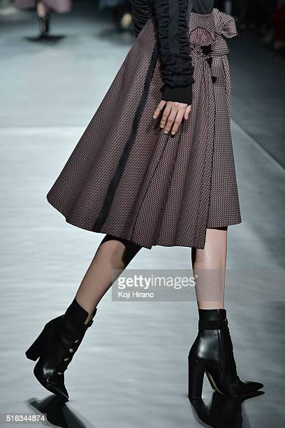 A model showcases designs on the runway during the ADEAM show as a part of Mercedes Benz Fashion Week TOKYO A/W 2016/2017 at Shibuya Hikarie on March...