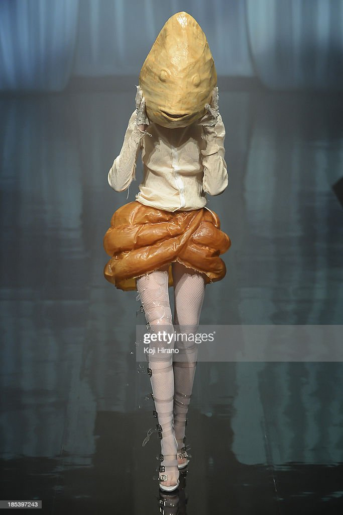 A model showcases designs on the runway during the Alice Auaa show as part of Mercedes Benz Fashion Week TOKYO 2014 S/S at Hikarie B Hall of Shibuya Hikarie on October 19, 2013 in Tokyo, Japan.