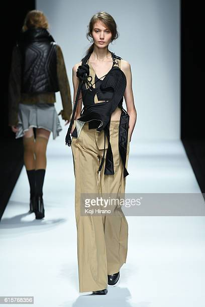 A model showcases designs on the runway during the Anne Sofie Madsen show as part of Amazon Fashion Week TOKYO 2017 S/S at Shibuya Hikarie on October...
