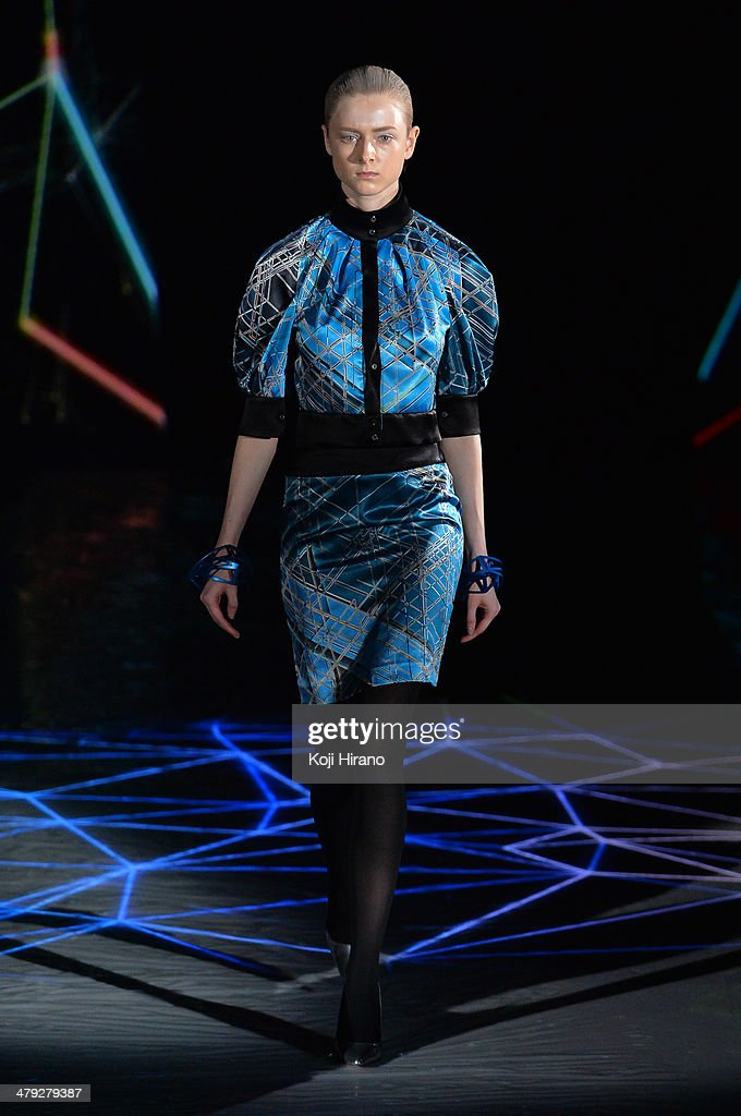 A model showcases designs on the runway during the Atsushi Nakashima - Runway - MBFW Tokyo 2014 A/W show as part of Mercedes Benz Fashion Week TOKYO 2014 A/W at Shibuya Hikarie on March 17, 2014 in Tokyo, Japan.
