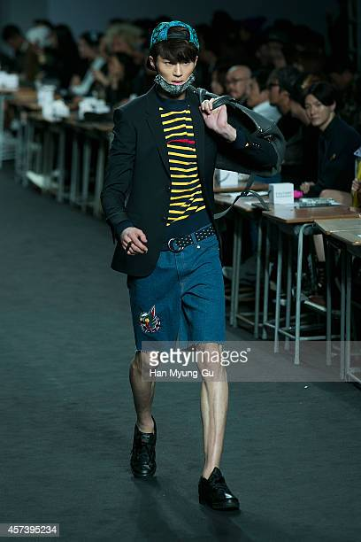 A model showcases designs on the runway during the Beyond Closet show as part of Seoul Fashion Week S/S 2015 at DDP on October 17 2014 in Seoul South...
