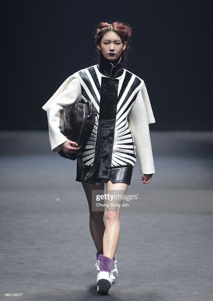 A model showcases designs on the runway during the BIG PARK show as part of Seoul Fashion Week F/W 2014 on March 23, 2014, in Seoul, South Korea.