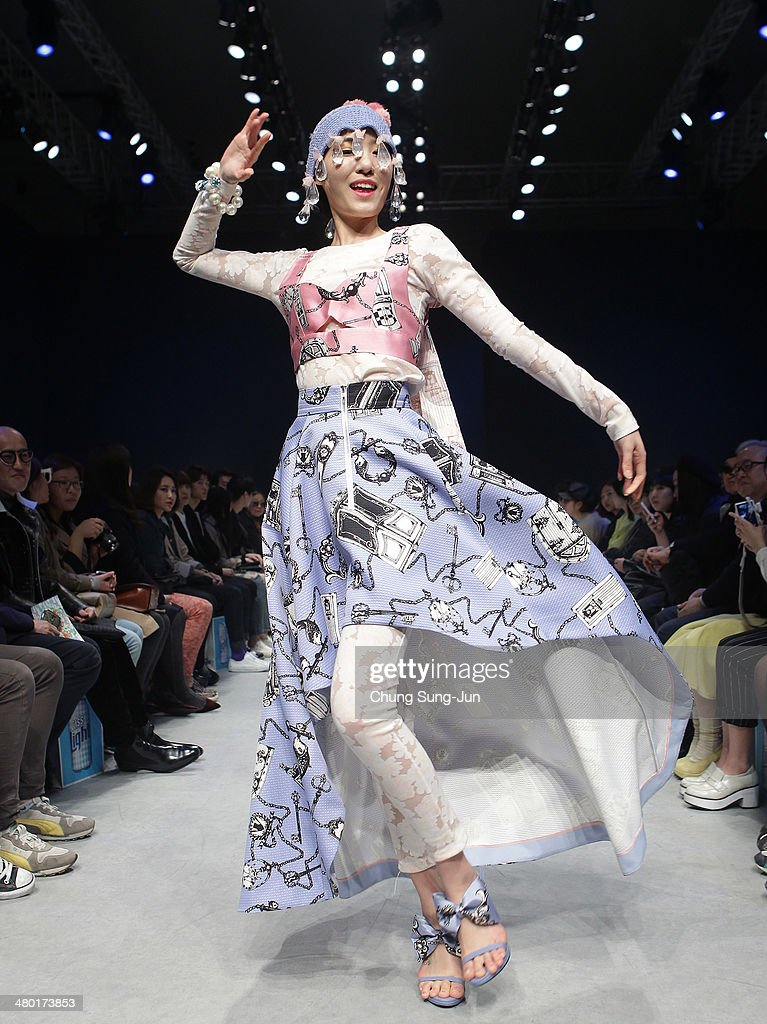 A model showcases designs on the runway during the chez HEEZIN show as part of Seoul Fashion Week F/W 2014 on March 23, 2014, in Seoul, South Korea.