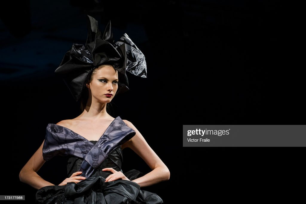A model showcases designs on the runway during the CUSCS show on day 2 of Hong Kong Fashion Week Spring/Summer 2013 at the Hong Kong Convention and Exhibition Centre on July 9, 2013 in Hong Kong, China.