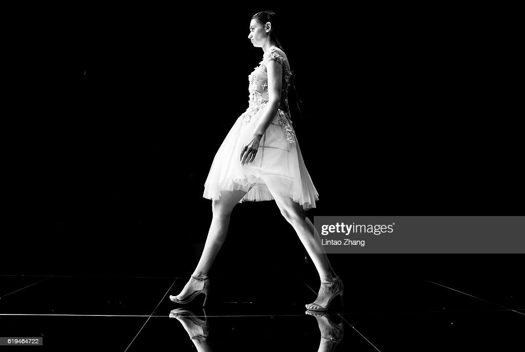 A model showcases designs on the runway during the Dennis wedding dress conference show during Mercedes-Benz China Fashion Week Spring/Summer 2017 at 751D park on October 31, 2016 in Beijing, China. China. The fashion week runs from 25 October to 02 November.