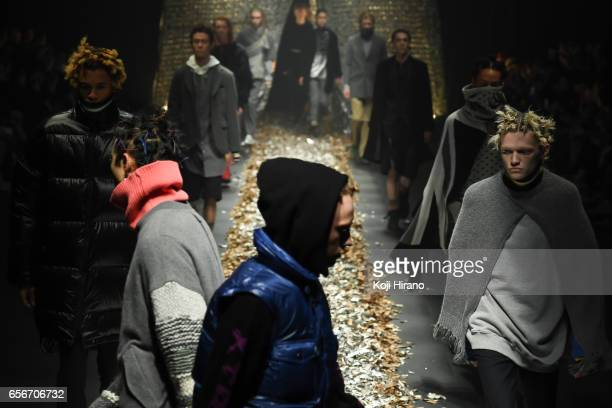 A model showcases designs on the runway during the DISCOVERED show as a part of Amazon Fashion Week Tokyo A/W 2017 at Shibuya Hikarie on March 22...