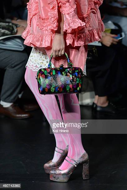 A model showcases designs on the runway during the DRESSCAMP show as part of Mercedes Benz Fashion Week TOKYO 2016 S/S at Shibuya Hikarie on October...