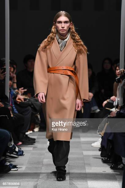 A model showcases designs on the runway during the ETHOSENS show as a part of Amazon Fashion Week Tokyo A/W 2017 on March 25 2017 in Tokyo Japan