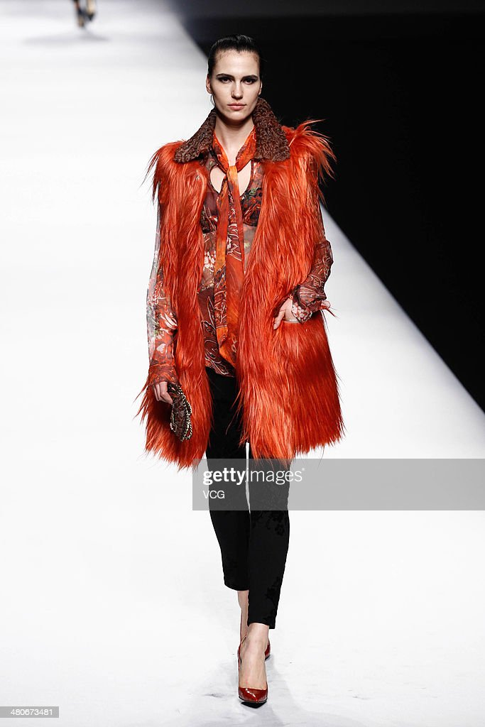 A model showcases designs on the runway during the Fur Fashion Collection show on day two of the Mercedes-Benz China Fashion Week Autumn/Winter 2014/2015 at Beijing Hotel on March 26, 2014 in Beijing, China.