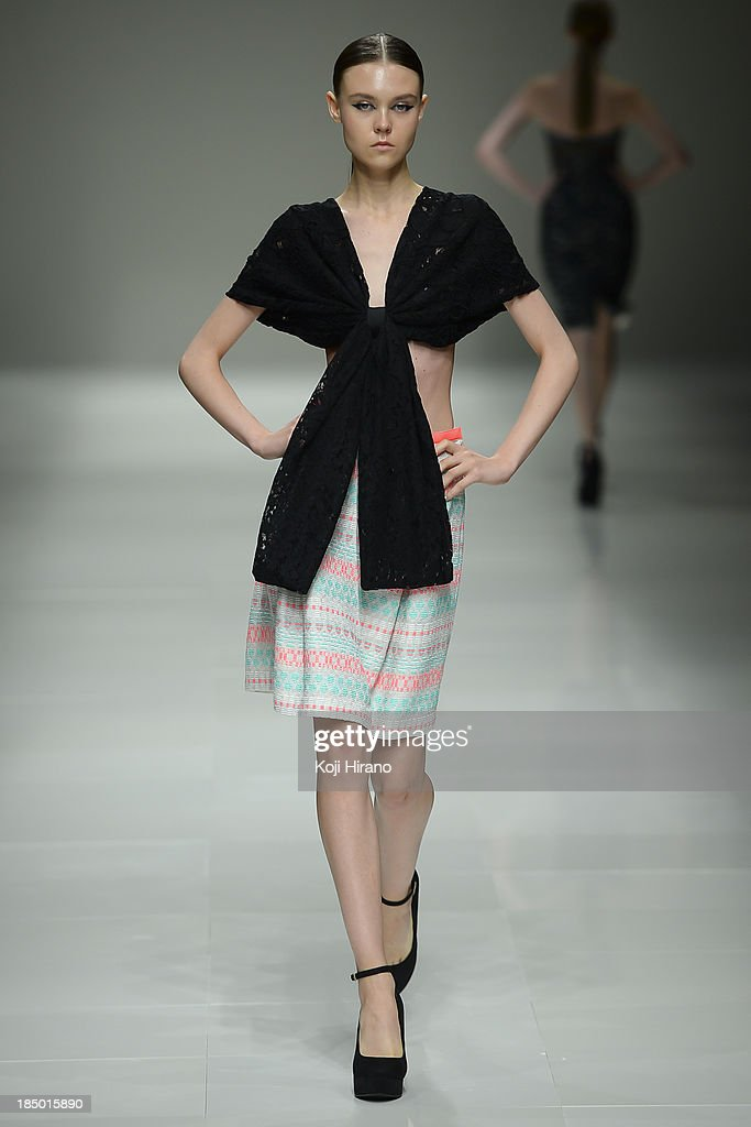 A model showcases designs on the runway during the Han Ahn Soon show as part of Mercedes Benz Fashion Week TOKYO 2014 S/S at Hikarie A Hall of Shibuya Hikarie on October 16, 2013 in Tokyo, Japan.