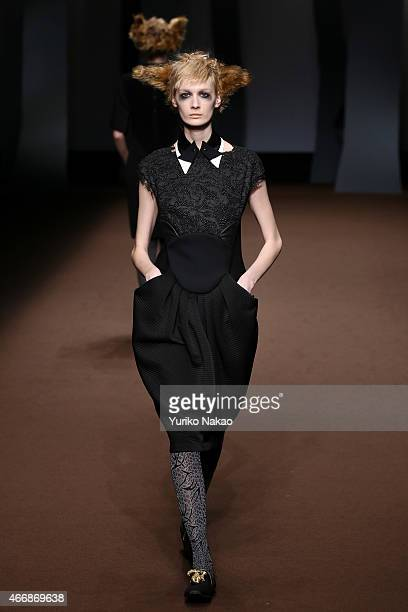 A model showcases designs on the runway during the HIROKO KOSHINO show as part of Mercedes Benz Fashion Week TOKYO 2015 A/W at The Garden Hall on...