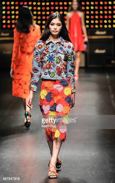 A model showcases designs on the runway during the House of Holland show as part of Mercedes Benz Fashion Week TOKYO 2015 S/S at Shibuya Hikarie on...