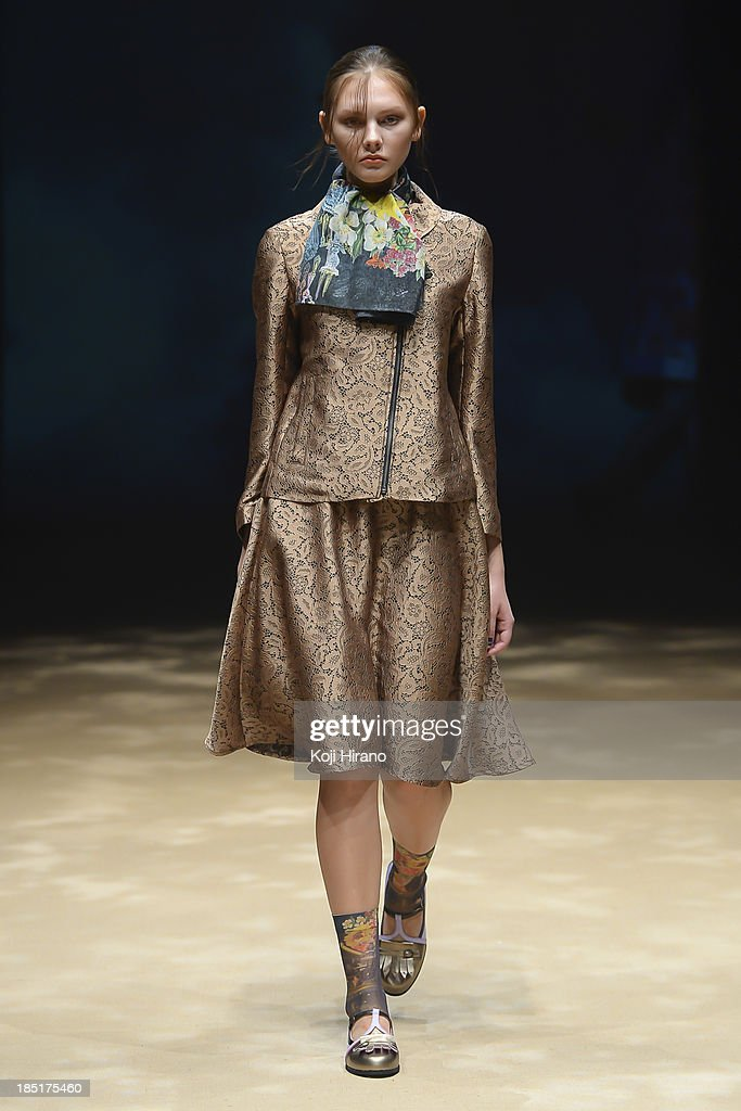 A model showcases designs on the runway during the In-Process by Hall Ohara show as part of Mercedes Benz Fashion Week TOKYO 2014 S/S at the Hikarie Hall B at Shibuya Hikarie on October 17, 2013 in Tokyo, Japan.
