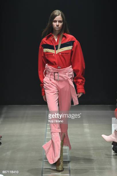 A model showcases designs on the runway during the KEISUKEYOSHIDA show as a part of Amazon Fashion Week Tokyo A/W 2017 at Shibuya Hikarie on March 23...