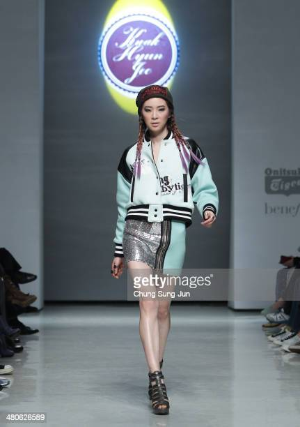 A model showcases designs on the runway during the Kwak Hyun Joo Collection show as part of Seoul Fashion Week F/W 2014 on March 26 in Seoul South...