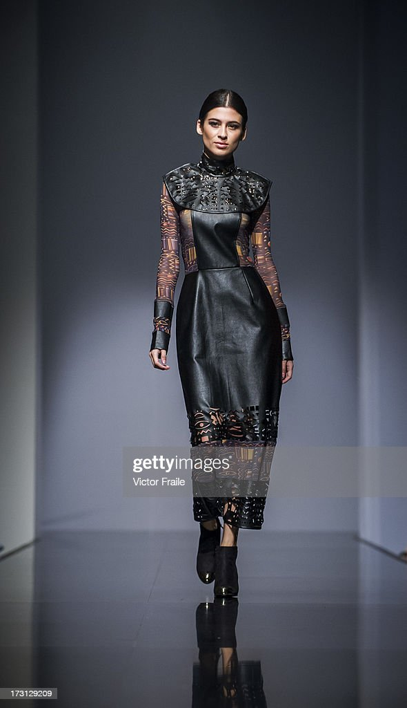 A model showcases designs on the runway during the MA Graduation Fashion Show 2013, by the Polytechnic University on day 1 of Hong Kong Fashion Week Spring/Summer 2013 at the Hong Kong Convention and Exhibition Centre on July 8, 2013 in Hong Kong, China.