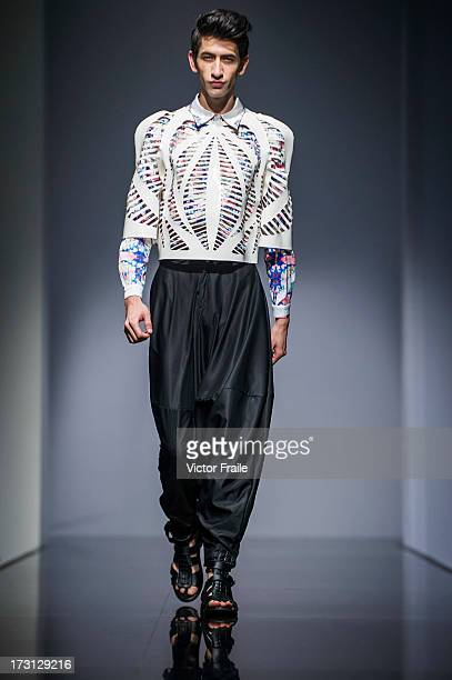A model showcases designs on the runway during the MA Graduation Fashion Show 2013 by the Polytechnic University on day 1 of Hong Kong Fashion Week...