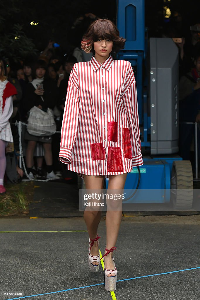 A model showcases designs on the runway during the MIKIO SAKABE show as part of Amazon Fashion Week TOKYO 2017 S/S at the Miyashita Park on October 22, 2016 in Tokyo, Japan.