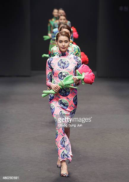 A model showcases designs on the runway during the Monte Milano show as part of Seoul Fashion Week F/W 2014 on March 24 in Seoul South Korea