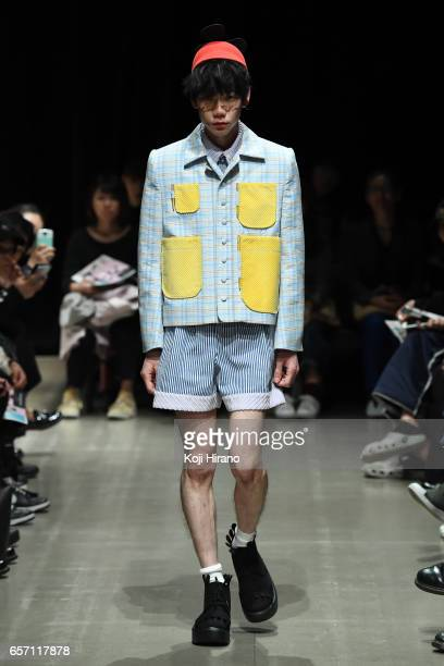 A model showcases designs on the runway during the MOTO GUO show as a part of Amazon Fashion Week Tokyo A/W 2017 at Shibuya Hikarie on March 23 2017...