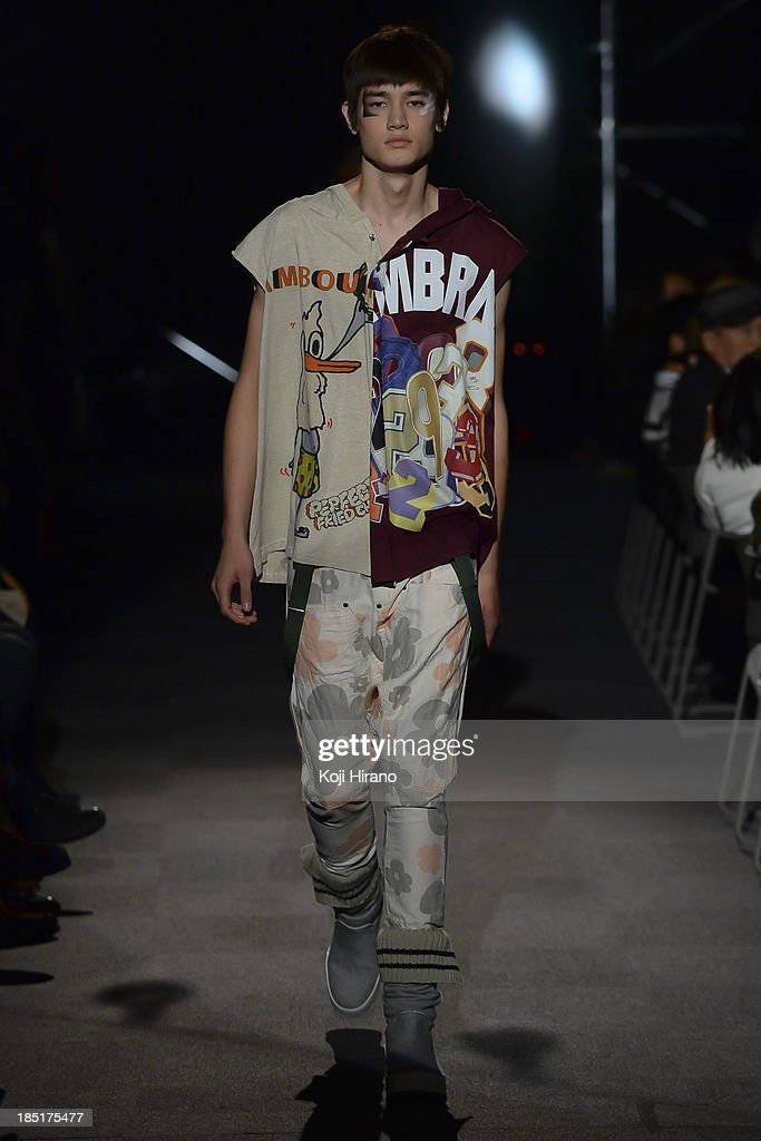 A model showcases designs on the runway during the Nozomi Ishiguro Haute Couture show as part of Mercedes Benz Fashion Week TOKYO 2014 S/S at the roomsLINK at bellesalle SHIBUYA GARDEN on October 17, 2013 in Tokyo, Japan.