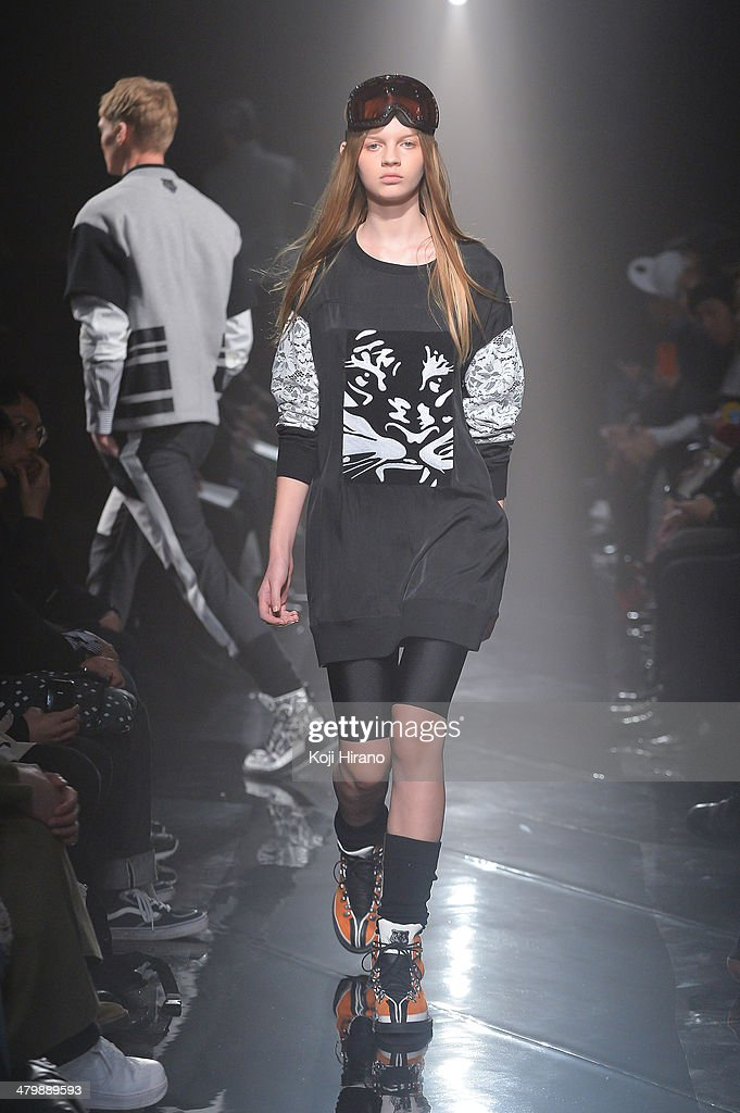 A model showcases designs on the runway during the Onitsuka Tiger x ANDREA POMPILIO show as part of Mercedes Benz Fashion Week TOKYO 2014 A/W at the bellesalle SHIBUYA GARDEN on March 20, 2014 in Tokyo, Japan.