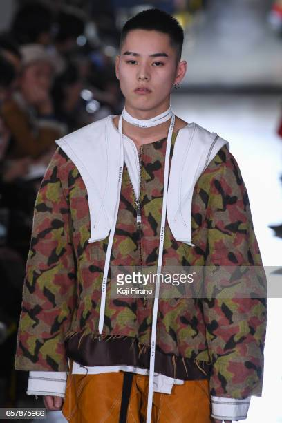 A model showcases designs on the runway during the salvam show as a part of Amazon Fashion Week Tokyo A/W 2017 on March 25 2017 in Tokyo Japan