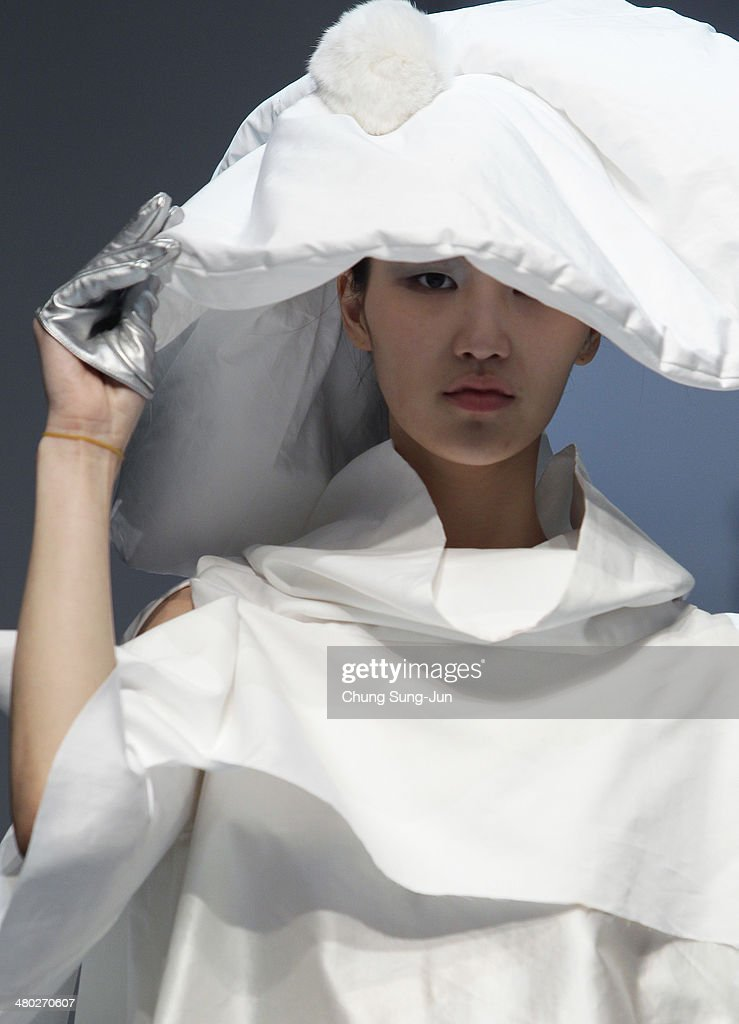 A model showcases designs on the runway during the Singapore Designers Showcase show as part of Seoul Fashion Week F/W 2014 on March 24, 2014, in Seoul, South Korea.