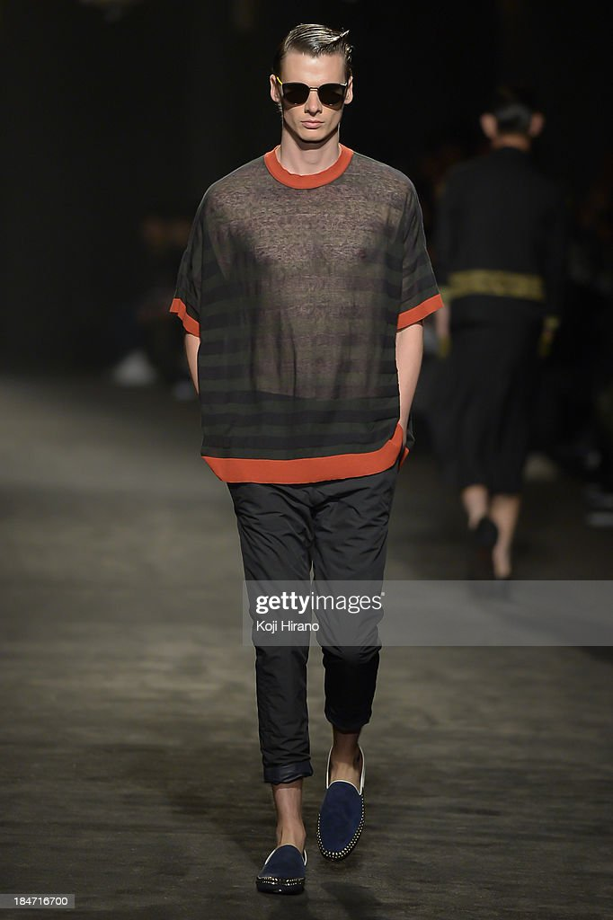 A model showcases designs on the runway during the Sise show as part of Mercedes Benz Fashion Week TOKYO 2014 S/S at the National Stadium on October 15, 2013 in Tokyo, Japan.