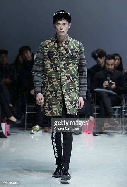 A model showcases designs on the runway during the Steve J and Yoni P show as part of Seoul Fashion Week F/W 2014 on March 24 in Seoul South Korea