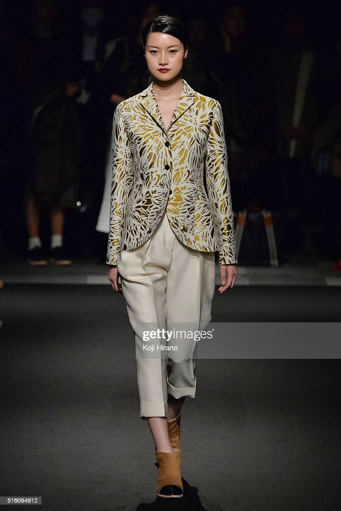 A model showcases designs on the runway during the support surface show as a part of Mercedes Benz Fashion Week TOKYO A/W 2016/2017 at Shibuya...