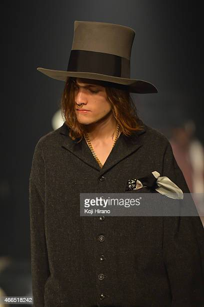 A model showcases designs on the runway during the TAKEO KIKUCHI show as part of Mercedes Benz Fashion Week TOKYO 2015 A/W at Shibuya Hikarie on...
