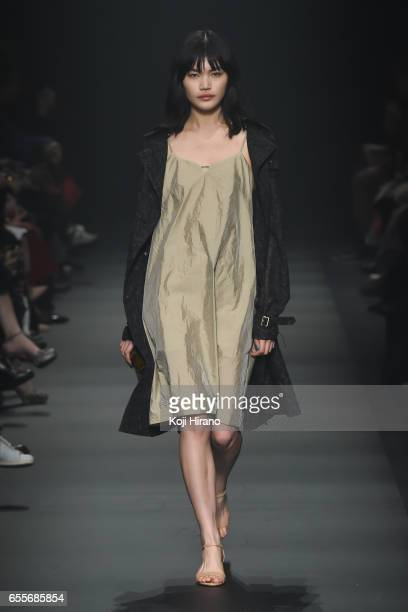 A model showcases designs on the runway during the tilt tokyo show as a part of Amazon Fashion Week Tokyo A/W 2017 at Shibuya Hikarie on March 20...