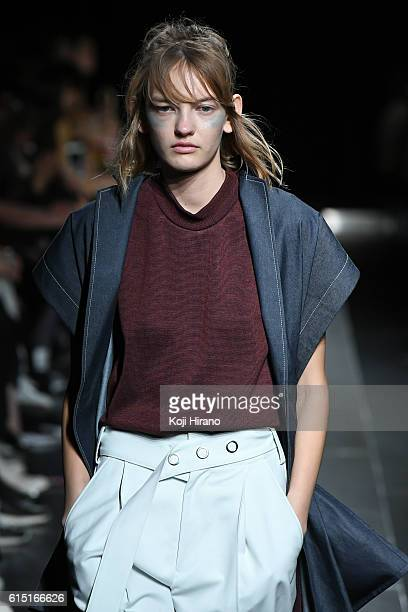 A model showcases designs on the runway during the Ujoh show as part of Amazon Fashion Week TOKYO 2017 S/S at Shibuya Hikarie on October 17 2016 in...
